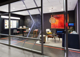 Collaborative meeting area enclosed with Steelcase VIA wall system