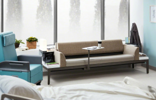 steelcase surround healthcare lounge product featuring movable tablet arm