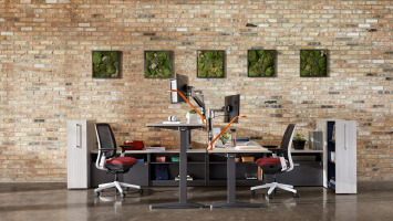 "steelcase ology height adjustable desks with 22"" high return storage units and high density storage towers"