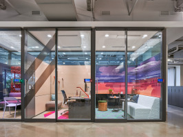 steelcase VIA modular wall system featuring glass fronts, black frames, and additional wall graphics